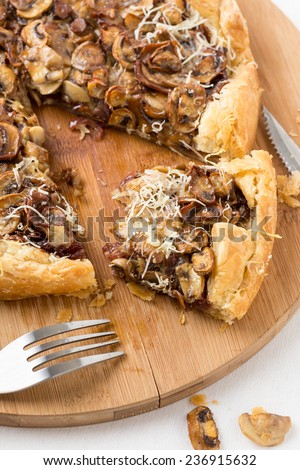 delicious mushroom pizza on cutting board. Vertical image. - stock photo