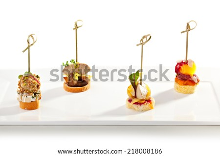 Delicious Mushrooms Canapes over White - stock photo