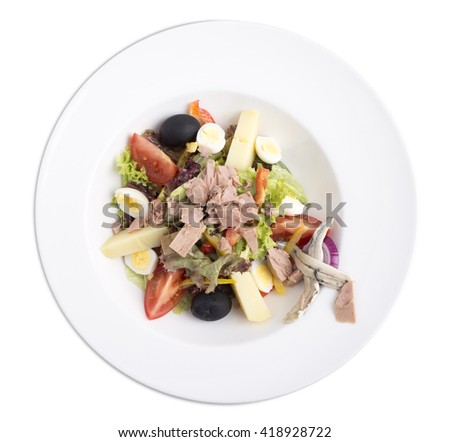 Delicious nicoise tuna salad with eggs and vegetables. Isolated on a white background. - stock photo