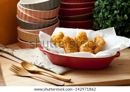 delicious nuggets with wooden spoon and fork - stock photo