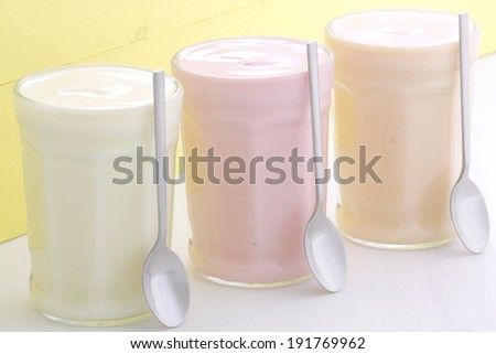 Delicious, nutritious and healthy fresh yogurt on vintage wood. - stock photo