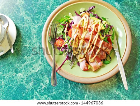 Delicious of Bacon salad on table - stock photo