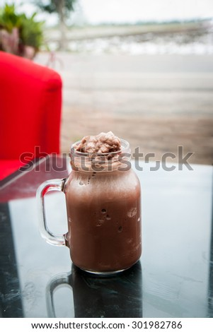 Delicious of chocolate frappe in glass cup with natural background - stock photo