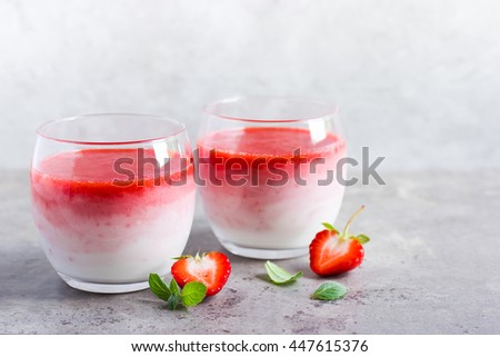 delicious ombre strawberry smoothie, selective focus - stock photo