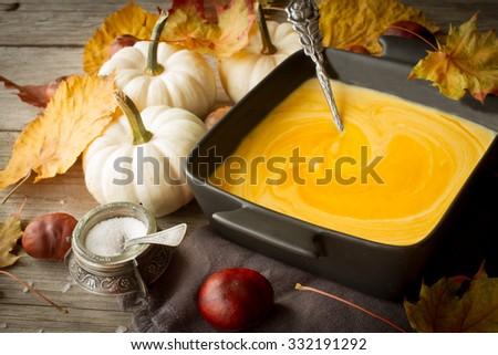 delicious, orange, autumn pumpkin soup. lunch at Halloween - stock photo
