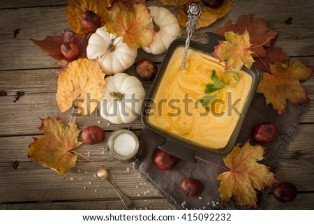 delicious, orange, autumn pumpkin soup. lunch at Halloween - stock photo