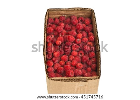 Delicious organic fresh raspberries in a cardboard box isolated on white background