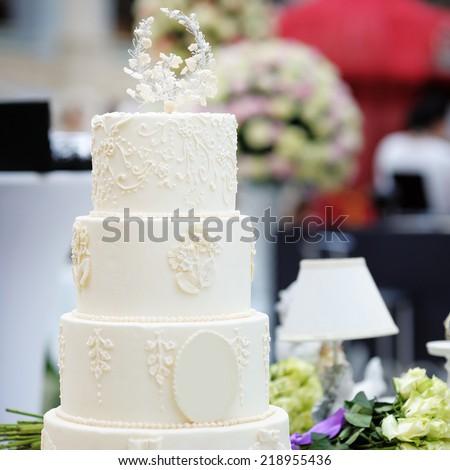 Delicious original white wedding cake  - stock photo
