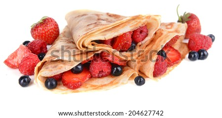 Delicious pancakes with berries isolated on white - stock photo