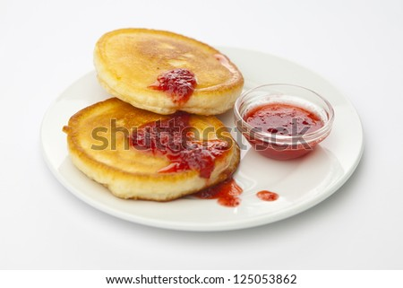 Delicious pancakes with jam  on plate - stock photo