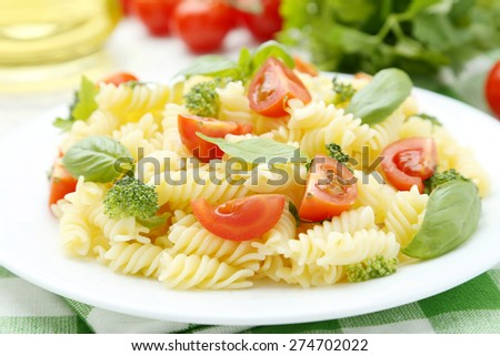 Delicious pasta on plate on white wooden background - stock photo