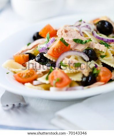 Delicious pasta salad with olives,cherry tomatoes and tuna - stock photo