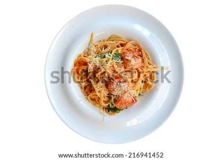 Delicious pasta spaghetti with shrimps and other seafood isolated on white