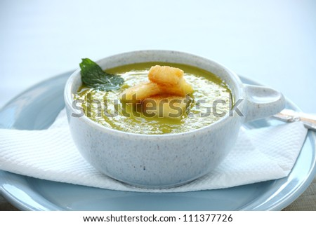 Delicious pea soup with fresh mint and ready to serve.