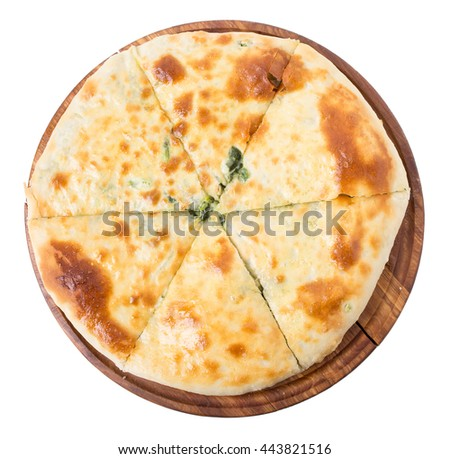 Delicious pie stuffed with spinach. Isolated on a white background.