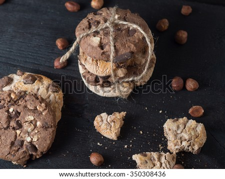 Delicious pile of chocolate chip cookies from the top on a dark wooden background - stock photo