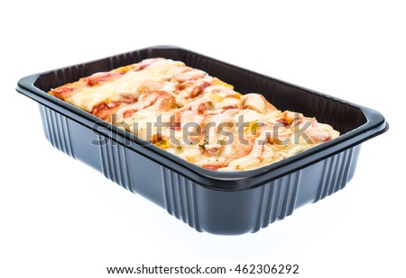 Delicious pizza in plastic container isolated on white background.