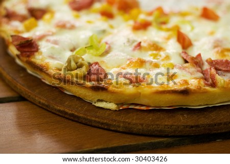 Delicious pizza. Just served on the table. - stock photo