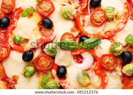 Delicious pizza with cheese and vegetables closeup