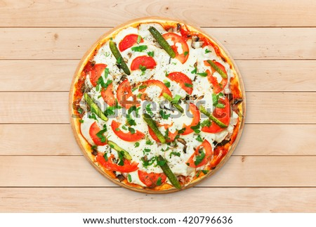 Delicious pizza with mushrooms and asparagus - thin pastry crust at wooden round desk at wood background. Italian food. Top view - stock photo