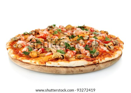 Delicious pizza with seafood on wooden stand isolated on white - stock photo