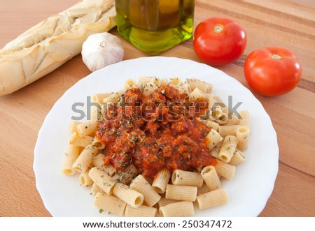 Delicious plate of macaroni with tomato ingredients background - stock photo