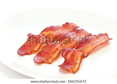 Delicious plate of wavy bacon - stock photo