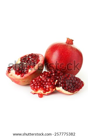 Delicious pomegranate fruit isolated on white