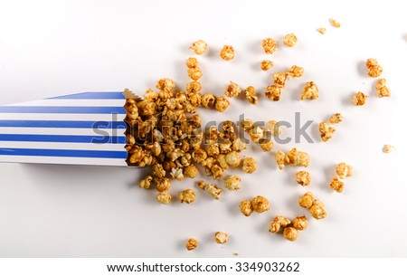 Delicious popcorn on the table - stock photo