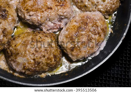 Delicious popular meat cutlet of beef meat with spices, cooked on prescription of Ukrainian cuisine, fried in oil until cooked. It is very nutritious tasty high-calorie product for gourmets of food. - stock photo