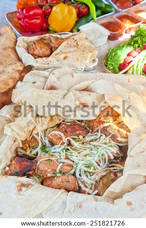 Delicious pork kebab with vegetables - stock photo