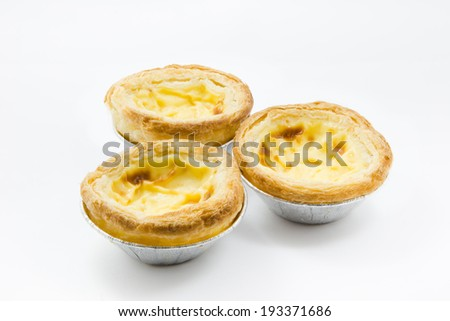 delicious portuguese egg tart on white background - stock photo