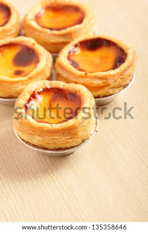 delicious portuguese egg tart with copy space on wooden texture table