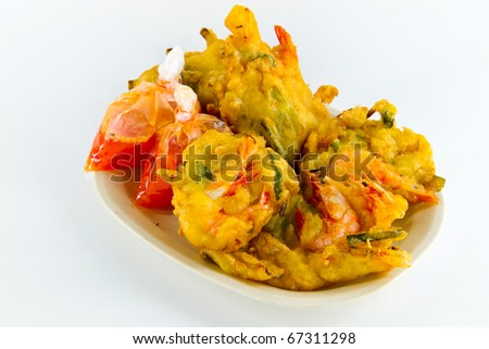 Delicious prawn fritters snack with packs of chili sauce isolated on white. Concept of asian snack.