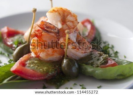 delicious prawns in tomato sauce on a beautiful white plate - stock photo