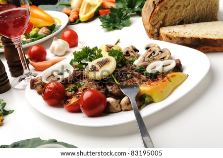 Delicious prepared and decorated food on table in restaurant - stock photo