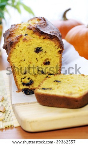 Delicious pumpkin bread with raisins - a favorite autumn tasty cake on a table - stock photo