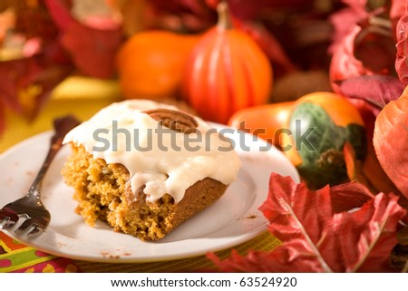 Delicious pumpkin cake with frosting.  Just in time for Autumn and Halloween. - stock photo
