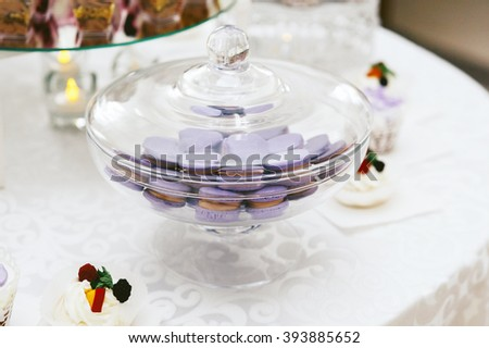 Delicious purple macaroons at wedding candy bar closeup - stock photo