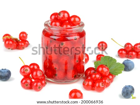 Delicious raw fresh red currant berries in a small jar with assorted berries around isolated on white background - stock photo