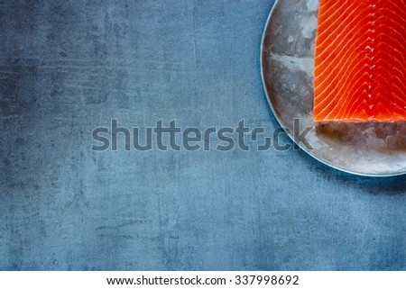 Delicious raw salmon fillet on old metal background with space for text. Top view. Bio Healthy food. - stock photo