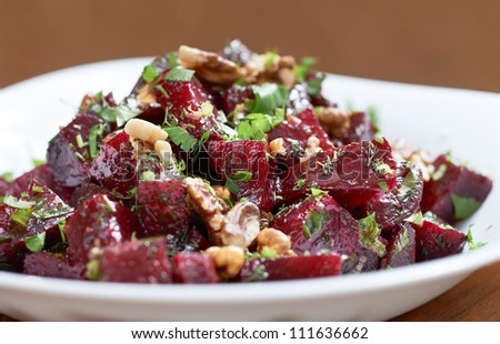 Delicious red beet salad with fennel and walnuts - stock photo