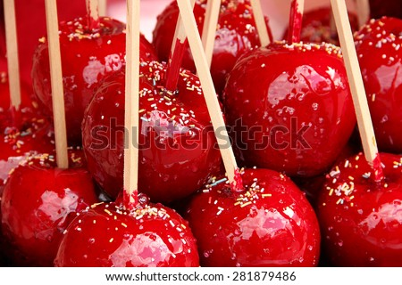 Delicious red candy apples covered with colorful sprinkles - stock photo