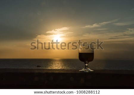 delicious red wine at sunset view