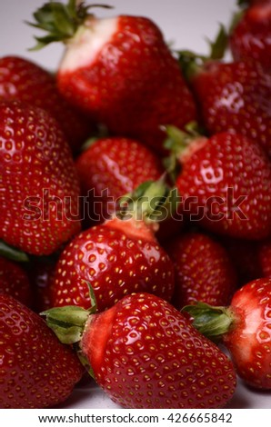 Delicious ripe strawberries isolated on white background. Healthy fruit eating. - stock photo