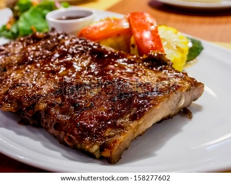 delicious roast pork rib won white dish - stock photo