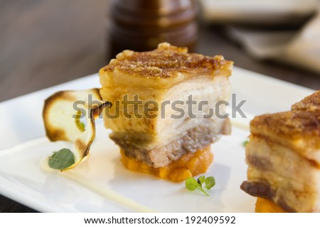Delicious roasted pork belly cubes on baked pumpkin with fried apple chips and a cauliflower puree with oregano and sage.
