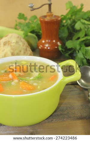 delicious rustic barley porridge with vegetables and parsley - stock photo