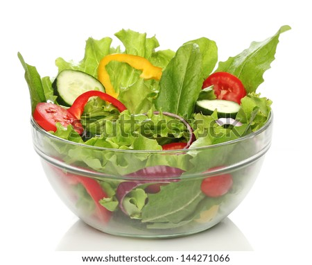 Delicious salad on a bowl isolated over white - stock photo
