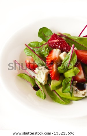 Delicious salad with chard, blue cheese, strawberry and balsamic vinegar. - stock photo